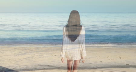abandonment : Digital composite of a woman walking towards the beach with waves in the foreground 4k Stock Footage