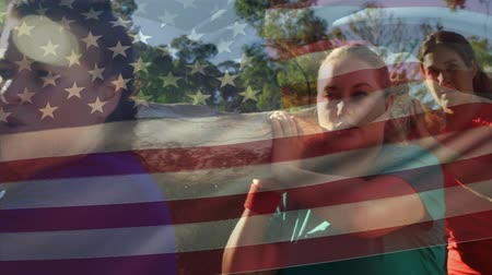 agacharse : Digital composite of a group of women carrying a log in the wilderness with an American flag waving in the foreground