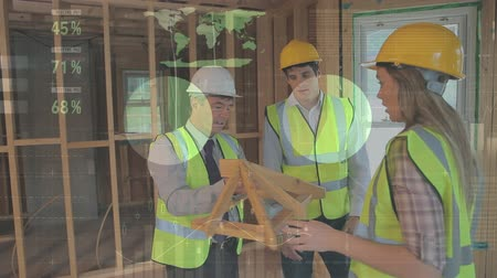 male : Digital composite of architects discussing structure design for building inside the construction site with graphs and statistics in the foreground Stock Footage