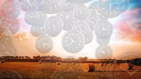 timeline : Digital composite of a wide farm field with clocks flying down in the foreground