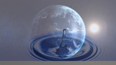 oceány : Digital composite of rotating globe with dripping water in the foreground