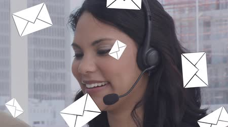 spam : Digital composite of a call centre agent talking on her headset with message icons flying in the foreground