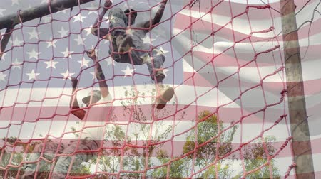 spangled : Digital composite of two American soldiers climbing down a cargo net with an American flag waving in the foreground
