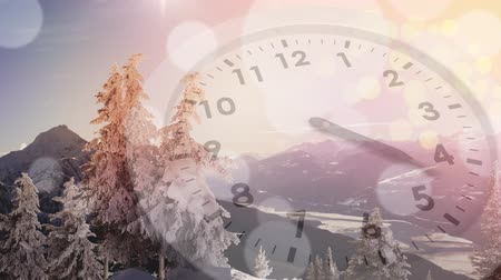 엿보기 : Digital composite frozen trees on mountains beginning to melt and the sun peeking with a clock running in the foreground