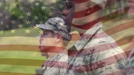 хмурый : Digital composite of American soldiers standing at attention with an American flag waving in the foreground