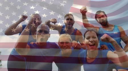 eufória : Digital composite of diverse team of American athletes celebrating with an american flag waving in the foreground