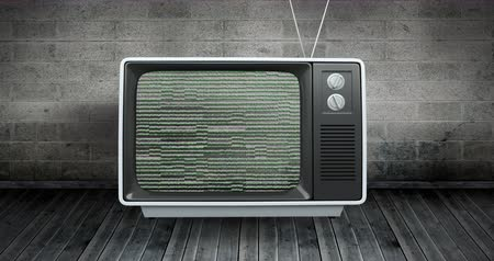 antiquado : Digitally generated animation of an old television with static on screen placed on wooden floor and a brick wall on the background. 4k Stock Footage
