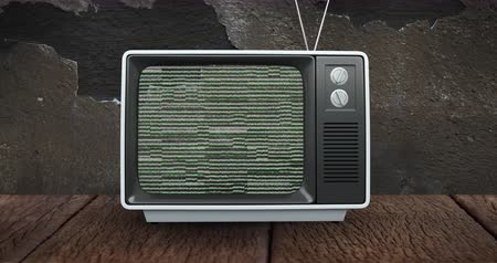 hangoló : Digital animation of an old television placed on a wooden floor and brick wall while there is static on the screen 4k
