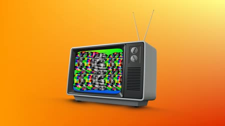 sintonizador : Digital animation of an old television with colorful static in the screen against an orange background Stock Footage