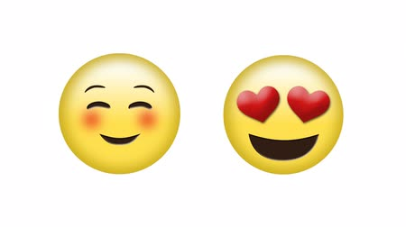 e mail : Digitally generated animation of the blushing emoji and face with heart eyes emoji. Stock mozgókép