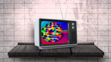 hangoló : Digital animation of an old television with colorful static placed in a wooden table against a dirty wall