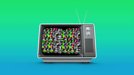 frekans : Digital animation of an old television with colorful static on the screen and background of blue and green. Stok Video