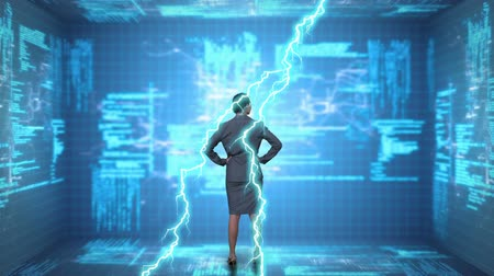comando : Digital composite of a businesswoman looking at a screen with program codes while lightning move in the screen
