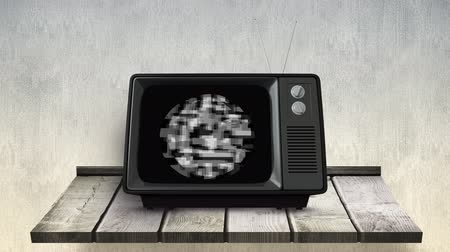 television set : Digital animation of old television with monochromatic static placed on top of a wooden table