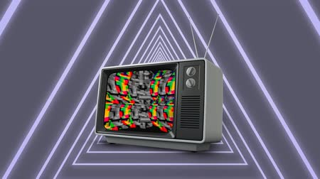 hangoló : Digital animation of an old television with colorful static while background shows futuristic triangles moving in the screen