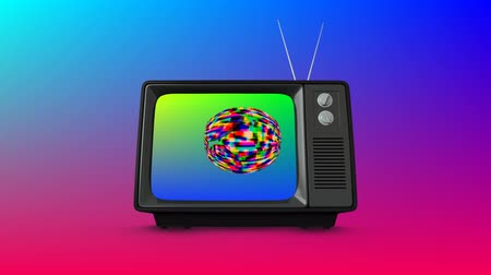 television set : Digital animation of an old television with colorful static in the screen and colorful background