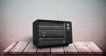 antiquado : Digital animation of an old television with static placed on a wooden deck 4k