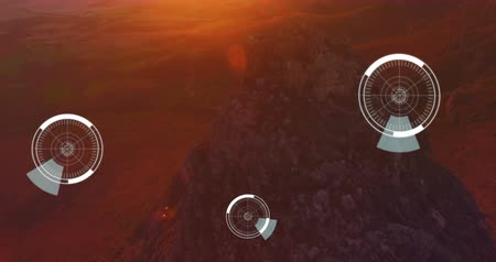 beheerder : Digital animation of futuristic circles moving around 5G with background of a rocky mountain during the sunset 4k