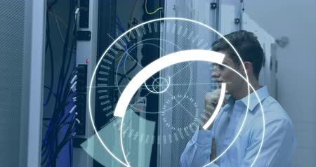 amministratore : Digital composite of a Caucasian technician looking at a server while futuristic circles around a 5G moving in the screen 4k