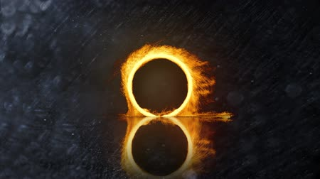 inflamável : Digital animation of a ring of fire zooming in on the screen against a grey textured background Vídeos