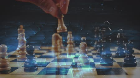 şövalye : Digital composite of a man playing chess with a background of a glowing square patterns