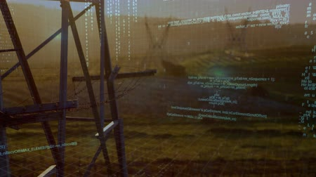 grassen : Digital animation of program codes moving in the screen with a background of a field with grasses and metal bars during the day