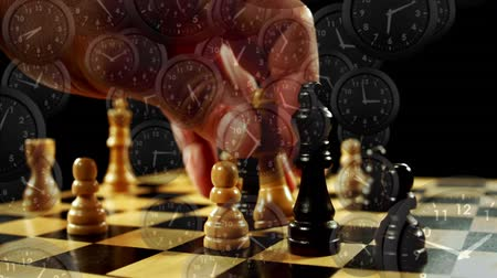 секунды : Digital composite of a man playing chess with black clocks moving in the screen