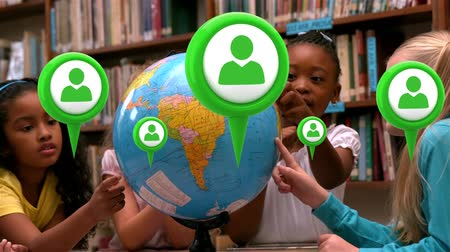 a böngésző : Digital composite of diverse kids looking at a globe in the library while profile in map pins float in the screen