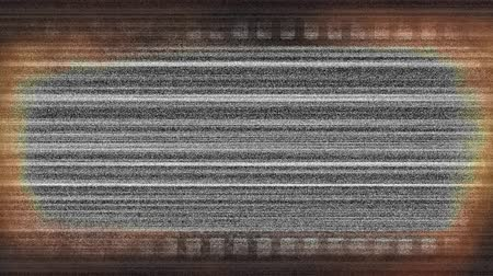 video reel : Digital animation of monochrome static moving in the screen framed by a film strip