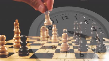 passatempo : Digital composite of a man playing chess with a clock in the background Stock Footage