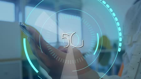innovation : Digital composite of a woman using a mobile phone while futuristic circles moving around 5G in the screen Stock Footage