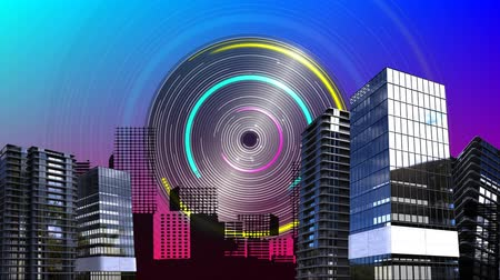 intelligencia : Digital animation of a spinning circle with yellow, blue, and pink colors spinning with buildings in the background Stock mozgókép