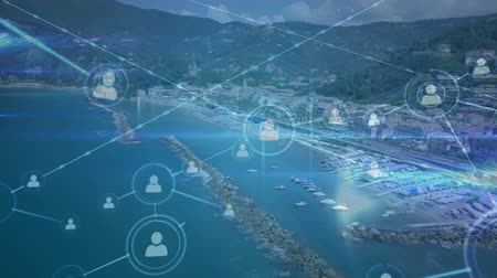 poblíž : Digital animation of profile icons connected by asymmetrical lines and a background of a view of the city near the coastline