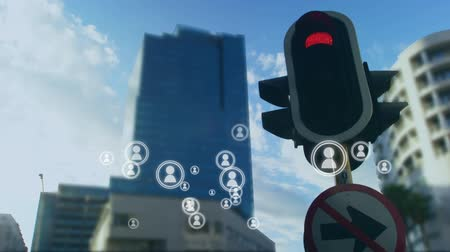 oluşturulan bilgisayar : Digital animation of people icon vectors with a background of traffic light signals and high-rise buildings.