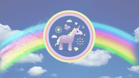 мифический : Digital animation of a pink unicorn with yellow mane inside two concentric circles of pink and yellow, surrounded with icons of flower, sun, butterfly, clouds, and heart. A rainbow appeared and formed from the right to the left, at the back of the unicorn