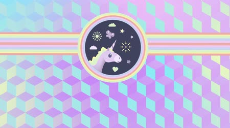 mitolojik : Digital animation of a beautiful cartoon of the head of a unicorn with flowers, sun, butterfly, heart, and clouds, inside two concentric circles that extend to the sides. 3d cubes of green to purple gradient as background Stok Video