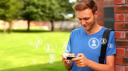 subscribers : Digital composite of Caucasian student in blue shirt playing on the mobile phone with people icon vectors popping on the screen.