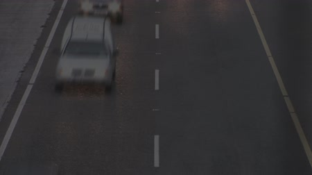 államközi : Digital animation of time lapse of moving cars on highway. Stormy sky is seen in the foreground with flashes of lightning