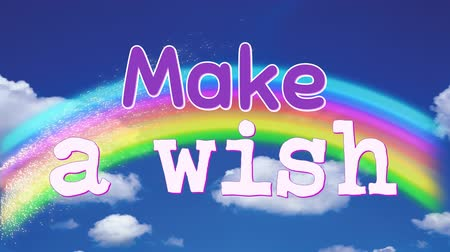 coisas : Make a wish phrase on a blue sky background with clouds and a rainbow. The letters are bouncing