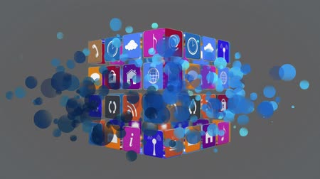 matemática : Digital animation of internet icons and symbols on a cube rotating with blue bokeh lights. The background is grey.