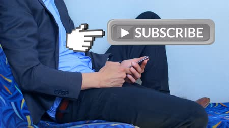 a böngésző : Digital composite of Caucasian business man in suit using mobile phone while sitting. A hand pointing icon moves beside grey subscribe button for social media.