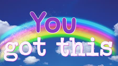 presente : Digital animation of You Got This text appearing in the screen with a background of the sky with clouds and rainbow. Stock Footage