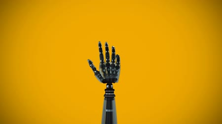 closing : Digitally generated animation of black robotic hand with palm opening and closing while rotating against a orange background with vignette. Stock Footage