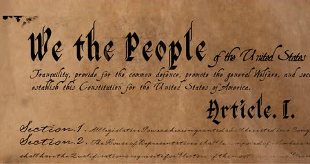 superbia : Digital animation of a written constitution of the United States zooming in and out of the screen against a brown paper-like textured background. 4k Filmati Stock