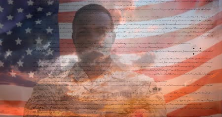alkotmány : Digital animation of a written constitution of the United States moving in the screen with a background showing the sky with clouds. An American flag waves behind an African-American military man in uniform. 4k