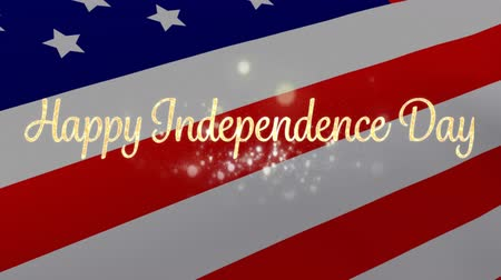 написанный : Digital animation of gold Happy Independence Day greeting while American flag waves in the background.