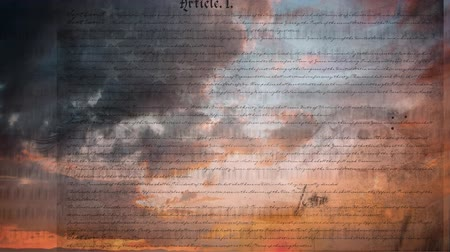 gurur : Digital animation of written constitution of the United States moving in the screen while background shows pair of eyes blinking and the sky with clouds during sunset Stok Video
