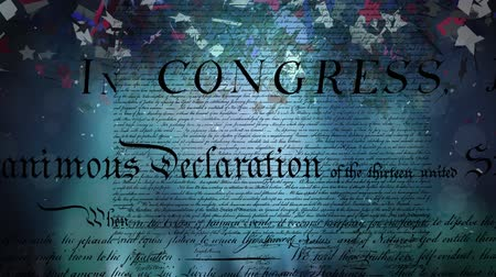 anayasa : Digital animation of the written declaration of independence of the United States moving in the screen while dark background shows lights moving and colorful confetti slowly falling in the screen. Stok Video