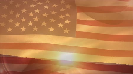 glória : Digital animation of the American flag waving while background shows the sun setting on plain