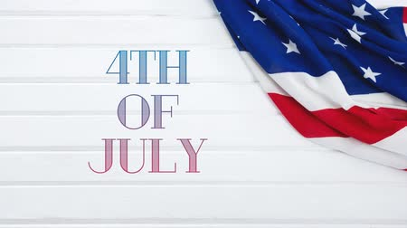 handschrift : Digital animation of 4th of July text zooming out in the screen and American flag in a white wall